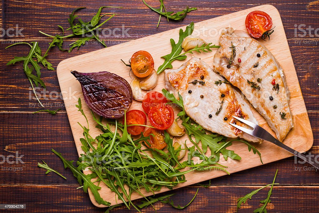 Grilled turkey and vegetables on a cutting board stock photo