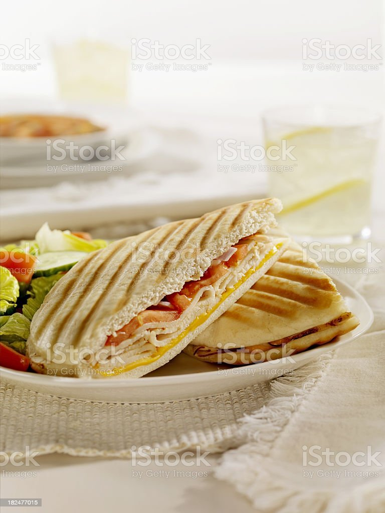 Grilled Turkey, Cheese and Tomato Panini royalty-free stock photo
