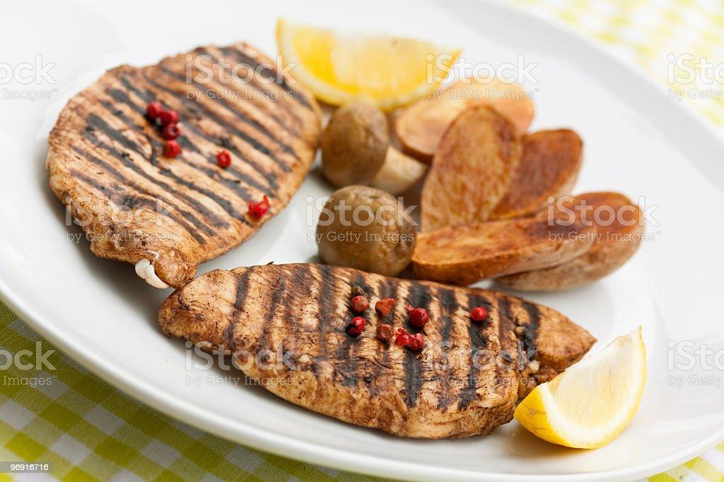 Grilled turkey fillet ,fried potato royalty-free stock photo