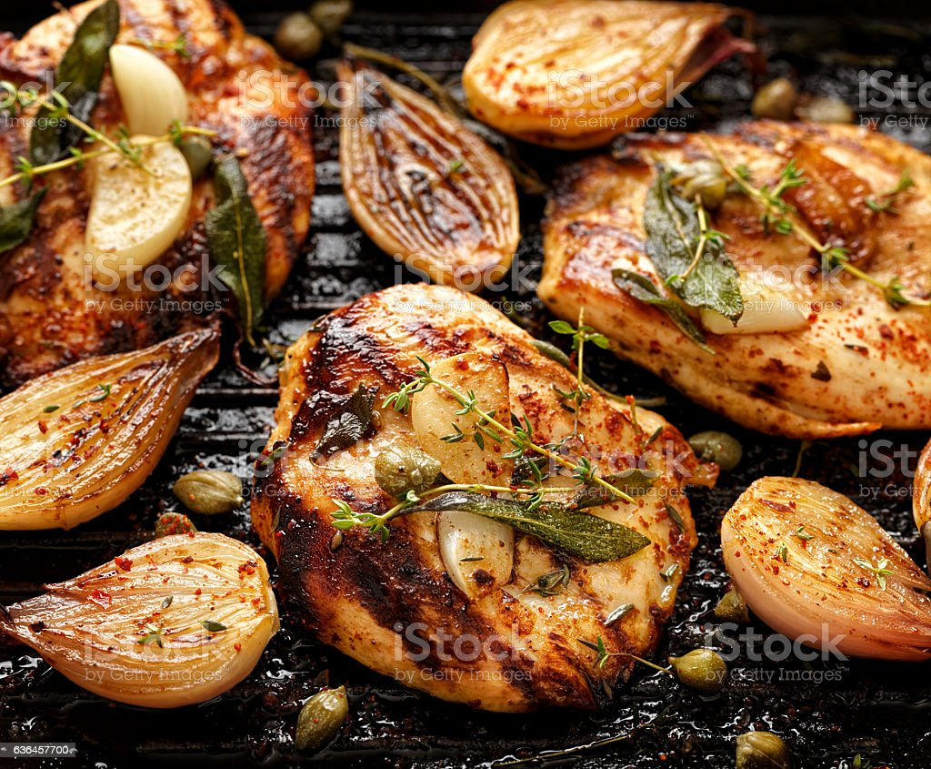 Grilled turkey fillet on the grill stock photo