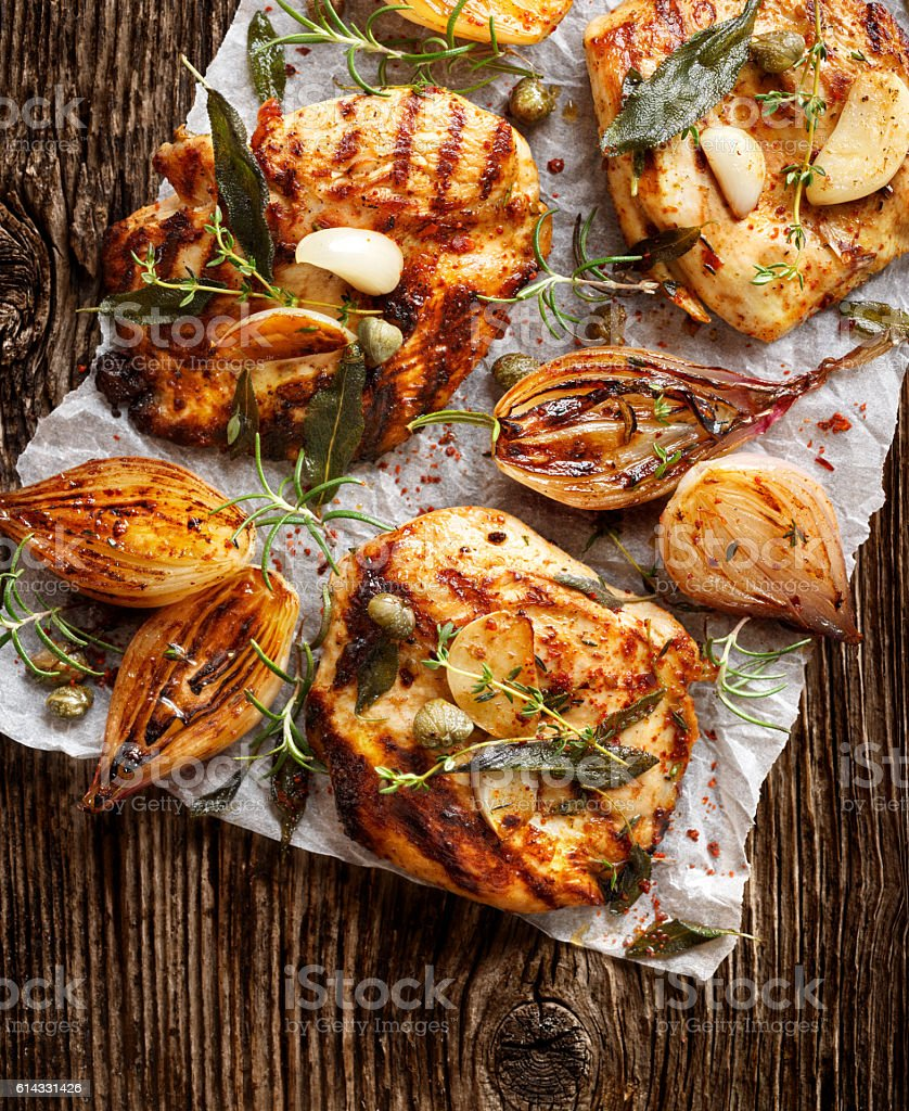 Grilled turkey fillets on a wooden table, top view stock photo