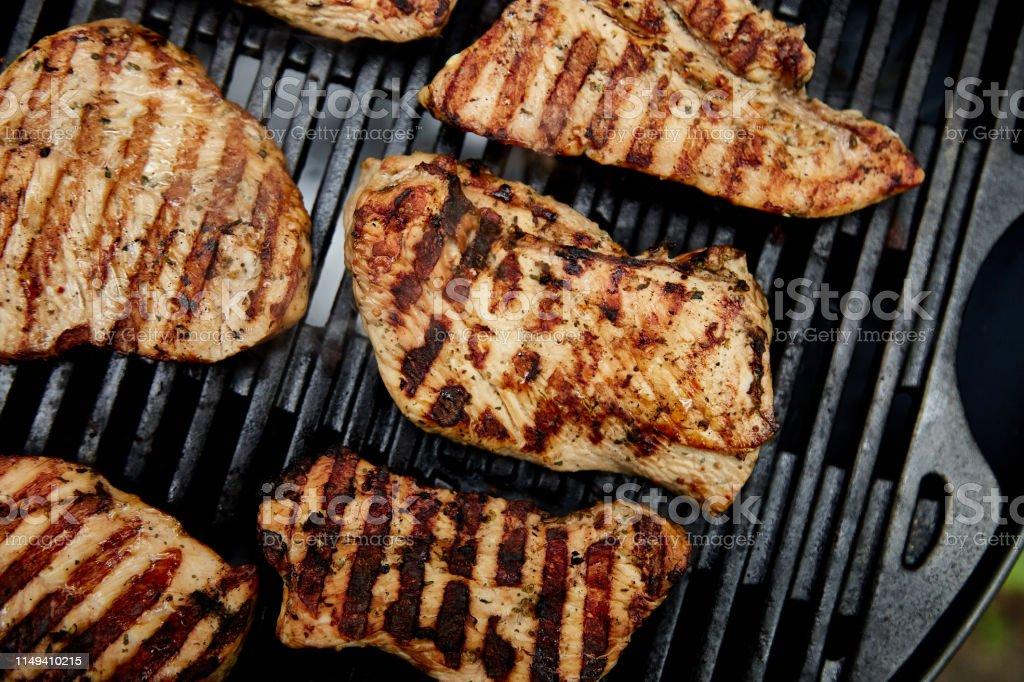 Grilled turkey meat. Steak turkey grill on on huge gas grill ....