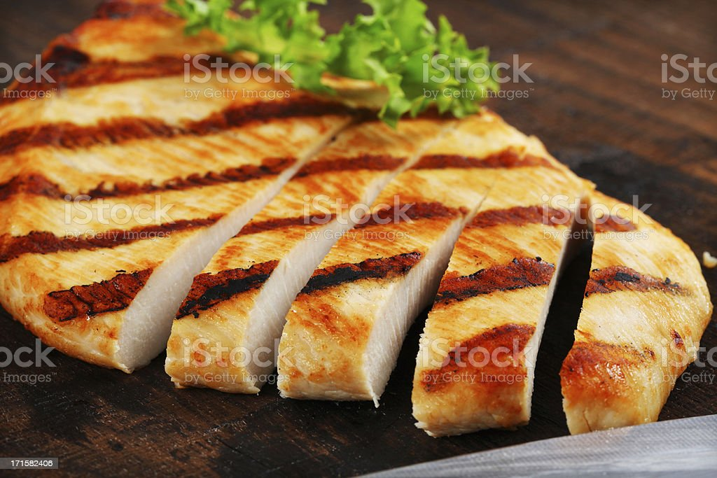 Grilled turkey steak on a wooden table royalty-free stock photo