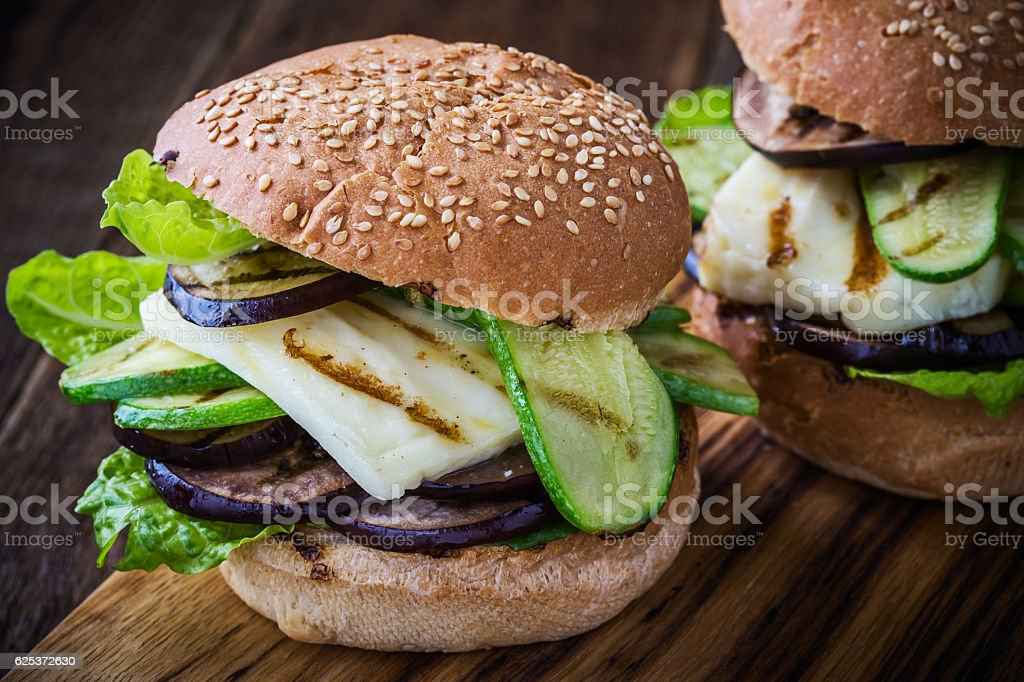 Grilled vegetable and haloumi burger with romaine lettuce stock photo