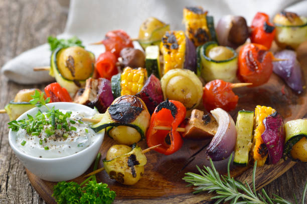 grilled vegetable skewers - grilled vegetables stock photos and pictures