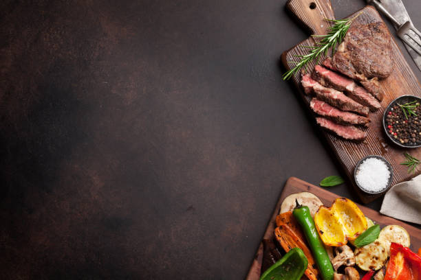 Grilled vegetables and beef steak stock photo