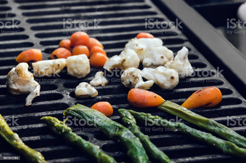 Grilled vegetables - green beans, cauliflower peppers and carrot. stock photo