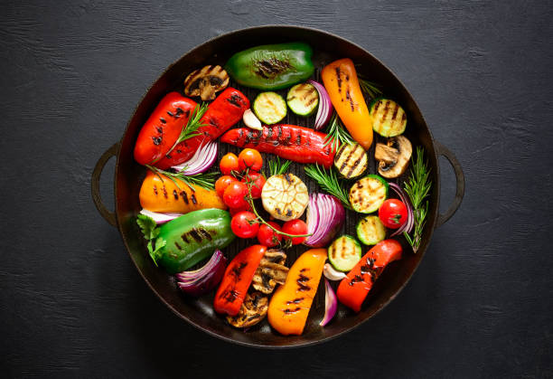 grilled vegetables in a grilling pan, top view - grilled vegetables stock photos and pictures