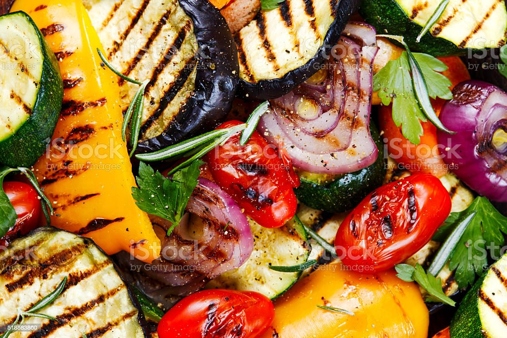 Grilled vegetables. On cutting dark board background stock photo