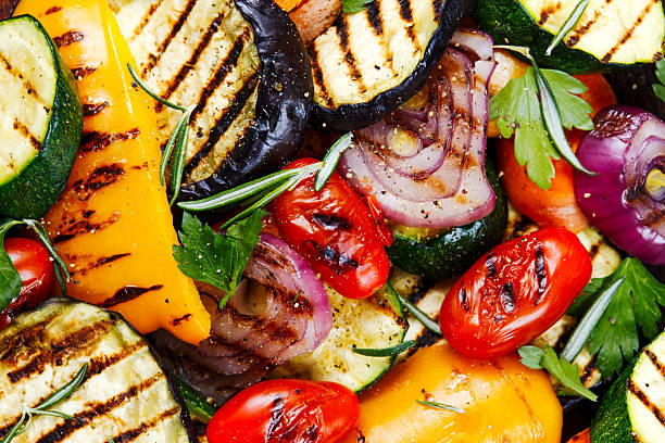 grilled vegetables. on cutting dark board background - grilled stock photos and pictures