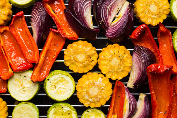 grilled vegetables on the pan - grilled vegetables stock photos and pictures