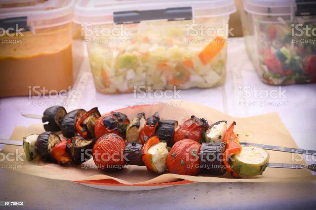grilled vegetables on vegan food market royalty-free stock photo