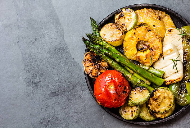grilled vegetables, pineapple slices and fresh cheese on iron plate - grilled vegetables stock photos and pictures