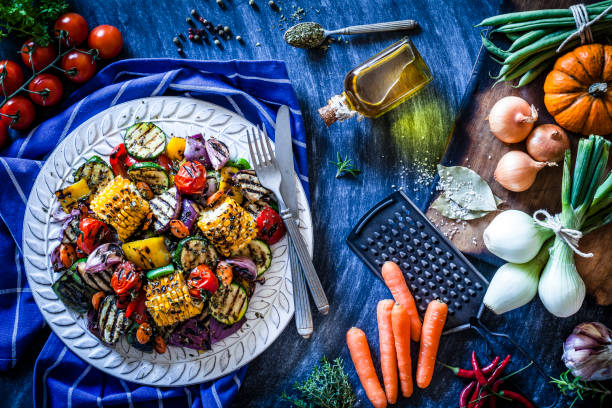 grilled vegetables plate shot from above on bluish kitchen table - vegetarian stock photos and pictures