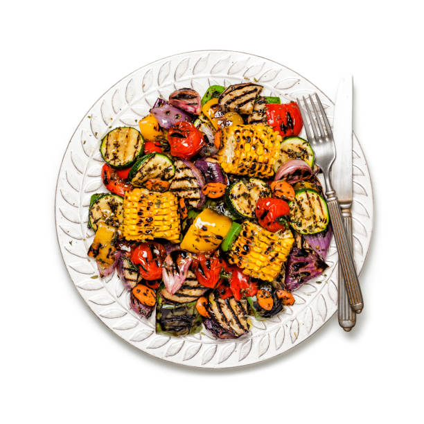 grilled vegetables plate shot from above on white background - grilled vegetables stock photos and pictures