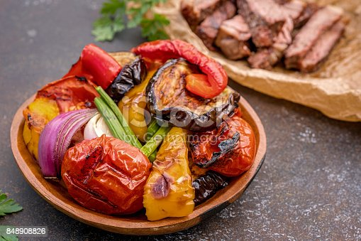 655793486 istock photo Grilled vegetables salad with eggplant, onions, peppers, asparagus, tomato 848908826