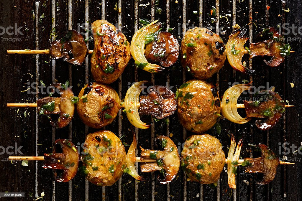 Grilled vegetraian skewers on grill pan stock photo
