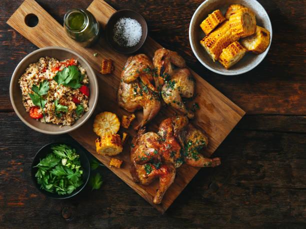 grilled whole butterflied chickens - girarrosto foto e immagini stock