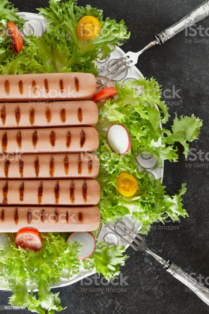 Grilled Wurst And Salad stock photo
