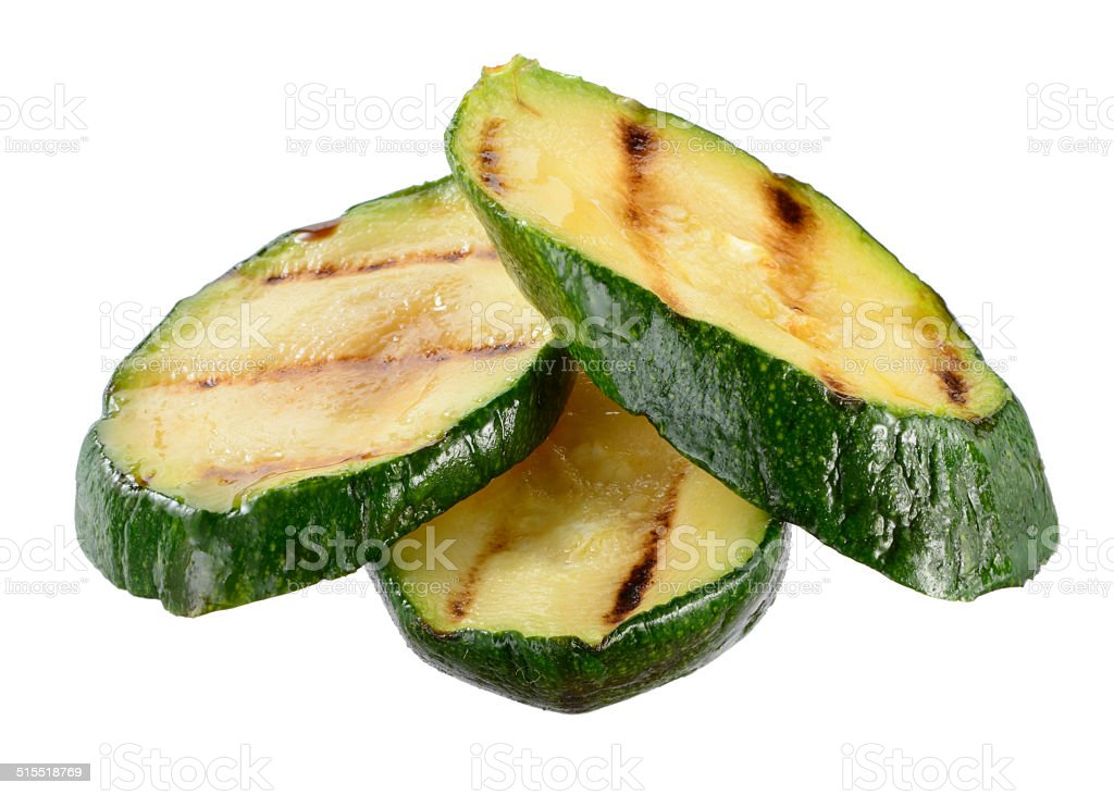 Grilled zucchini slices isolated on white background stock photo