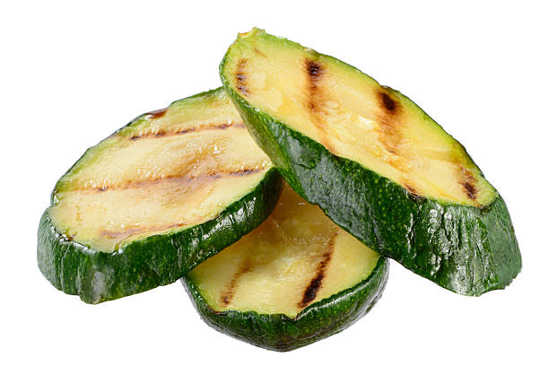 Grilled zucchini slices isolated on white background Grilled zucchini slices isolated on white background squash vegetable stock pictures, royalty-free photos & images