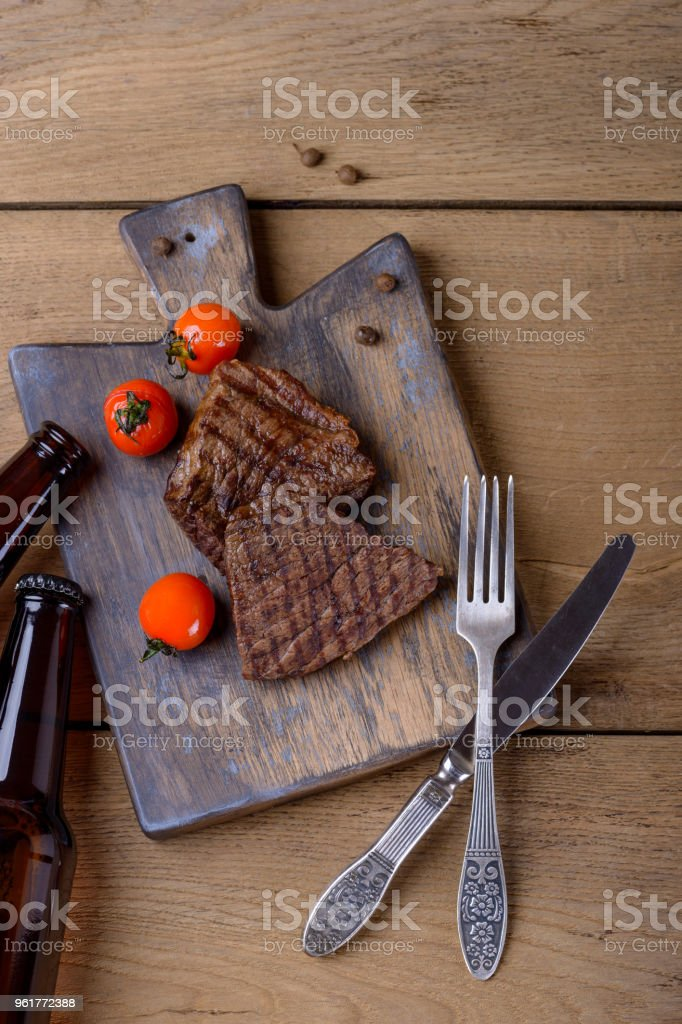 Griller steak and tomatos with beer stock photo