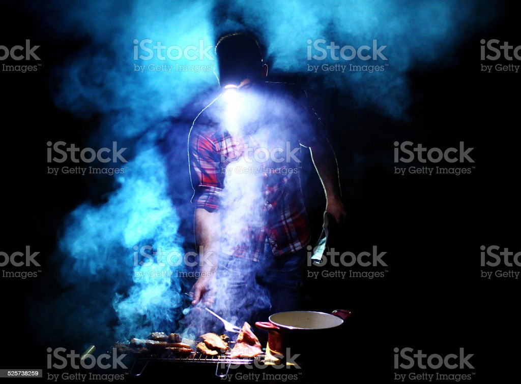 Grilling at night. stock photo