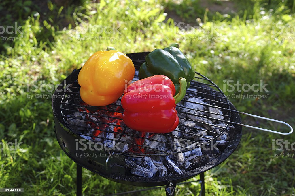 Grilling bell peppers on barbecue grill royalty-free stock photo
