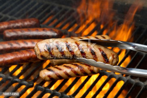 Bratwurst on a flaming grill