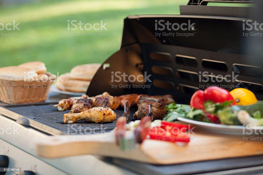 Grilling meat and vegetables stock photo
