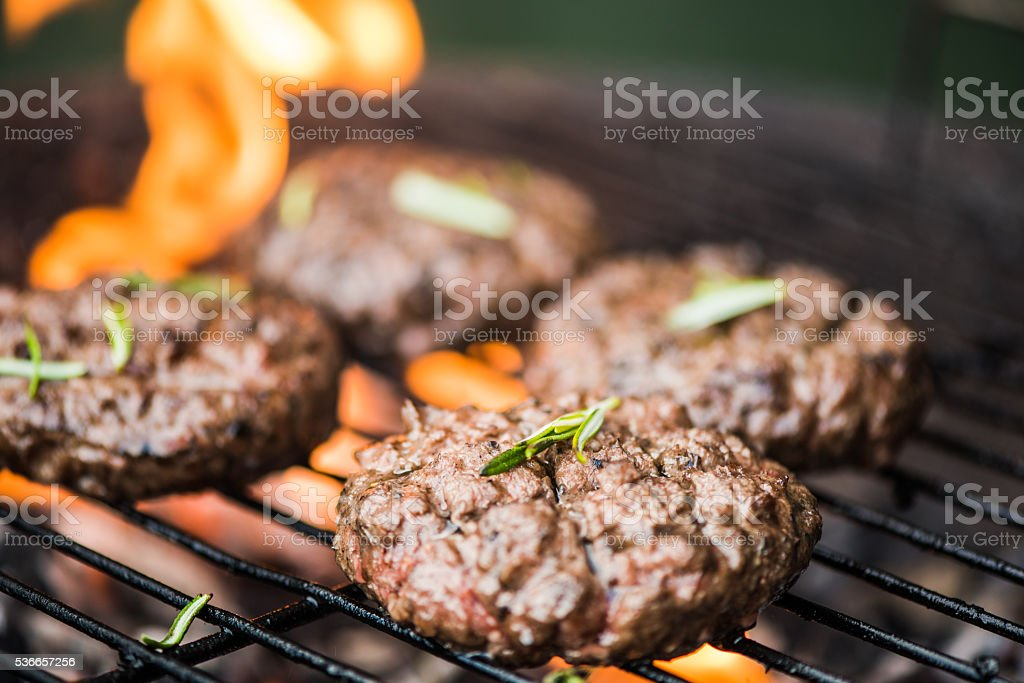 grilling meat on bbq flames stock photo