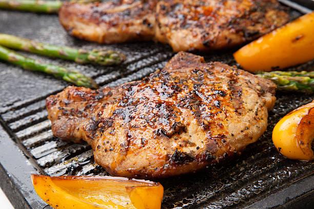 Grilling Pork Chops stock photo