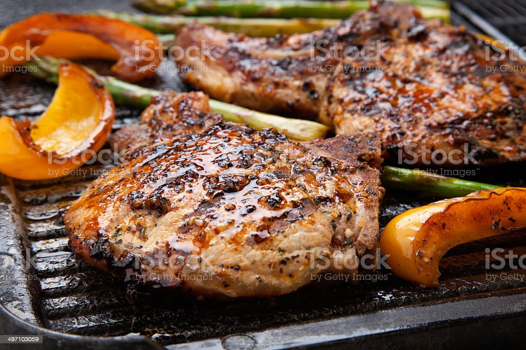 Grilling Pork Chops stock photo
