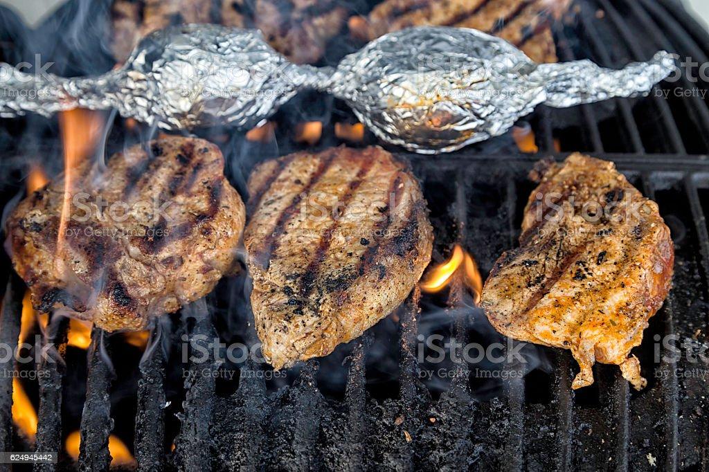 Grilling pork stock photo