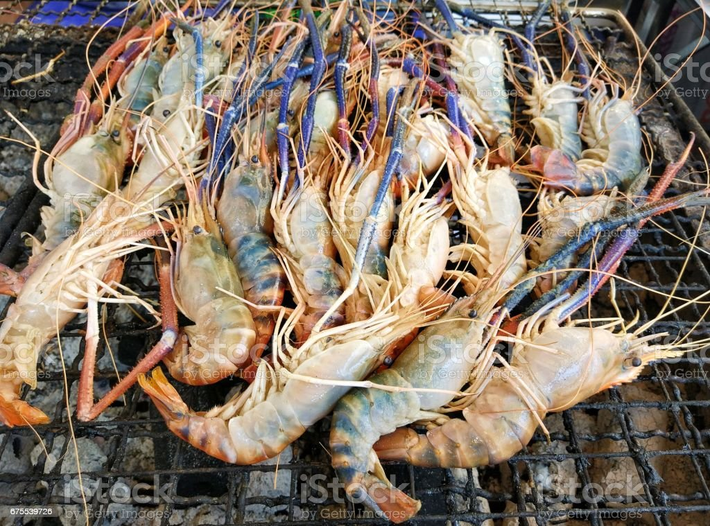 Grilling prawn seafood on on the stove royalty-free stock photo