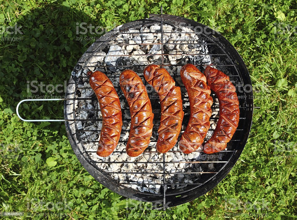 Grilling Sausages on barbecue grill stock photo