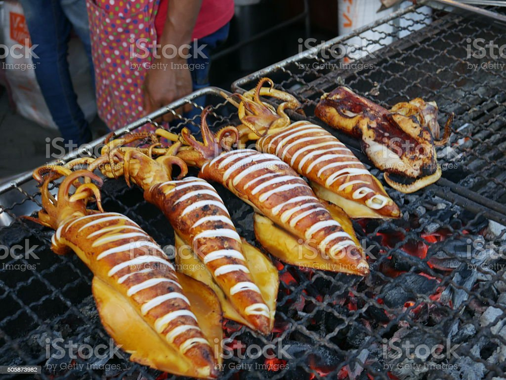 Grilling squid, Street Food, Thailand stock photo