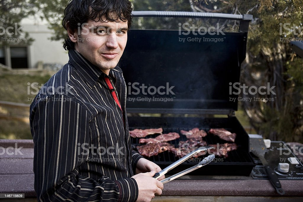 Grilling steak royalty-free stock photo