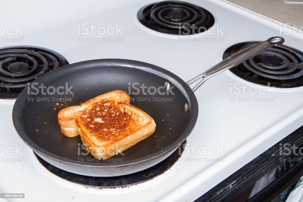 Grilling up a cheese sandwich stock photo