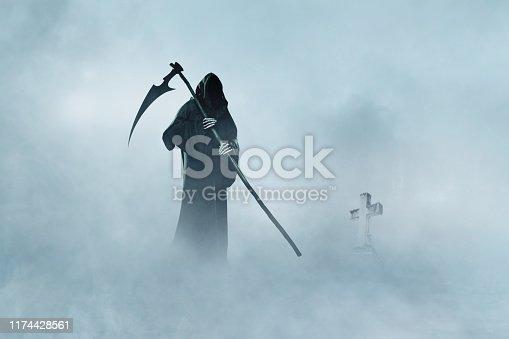 Grim Reaper walking in fog. Halloween.