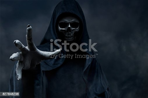 Grim Reaper on dark background