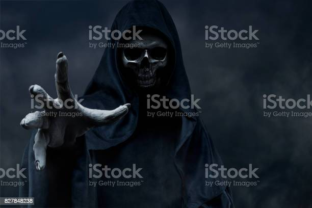 Grim Reaper on dark background