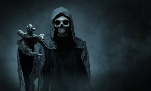 Grim reaper reaching towards the camera stock photo