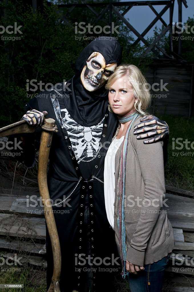 Grim Reaper with girl stock photo