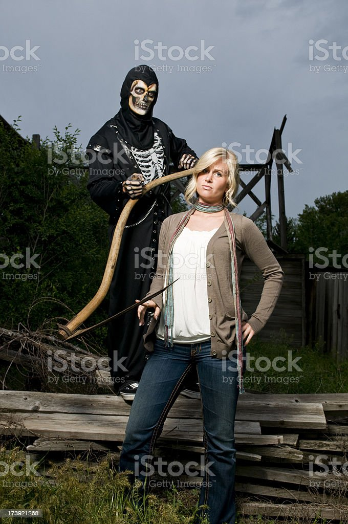 Grim Reaper with scythe stock photo