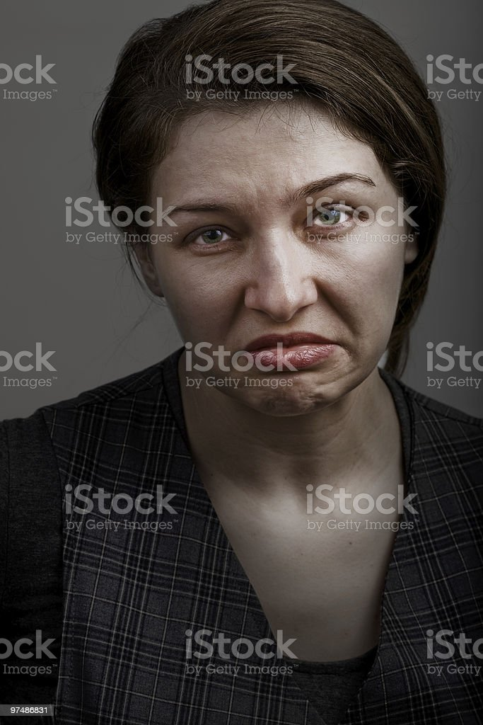 Grimace of unhappy sad disappointed woman royalty-free stock photo