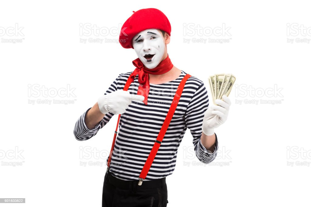grimacing mime pointing on money isolated on white stock photo