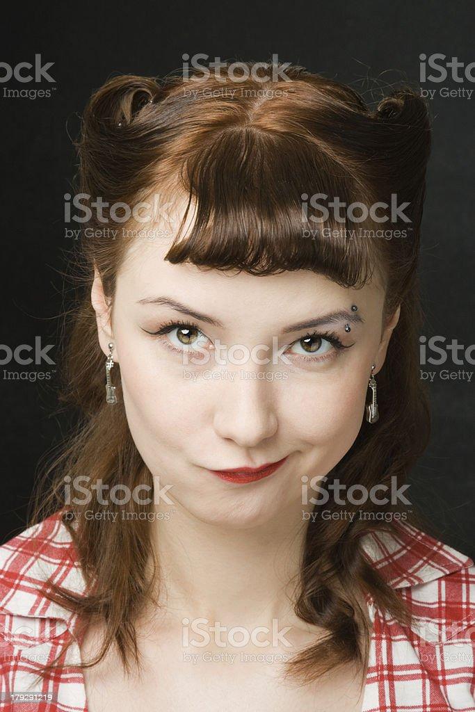 Grimacing pin-up woman stock photo