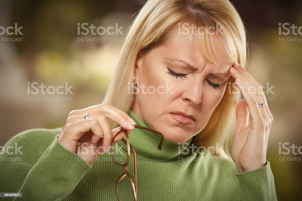 Grimacing Woman Suffering a Headache royalty-free stock photo