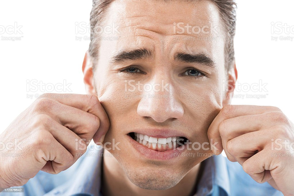 Grimacing young man stock photo